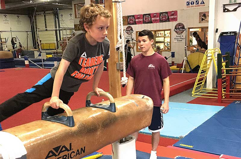 Boys Recreational Classes - coach assisting with pommel horse
