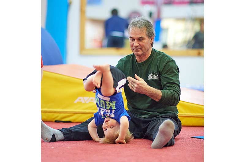 Preschool Recreational Classes - coach assisting with tumble