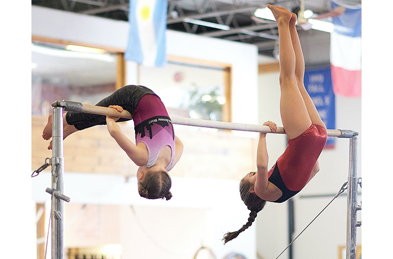 Girls Gymnastics on high bar