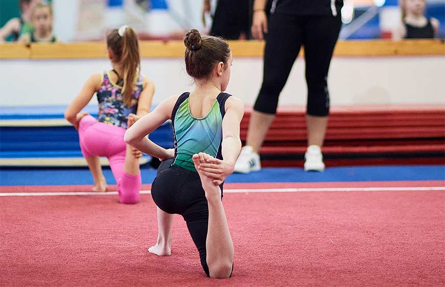 Girls stretching - semi-private gymnastics classes