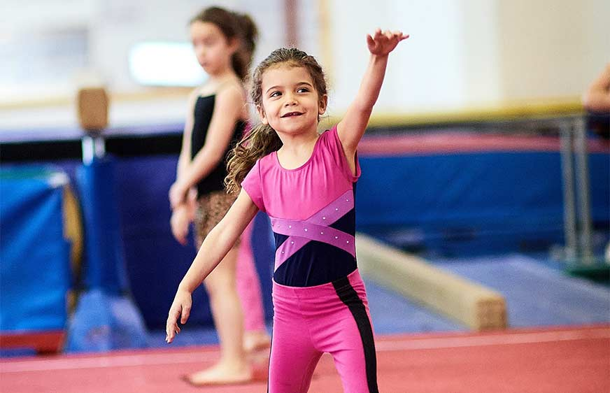 Girl on floor - semi-private gymnastics classes