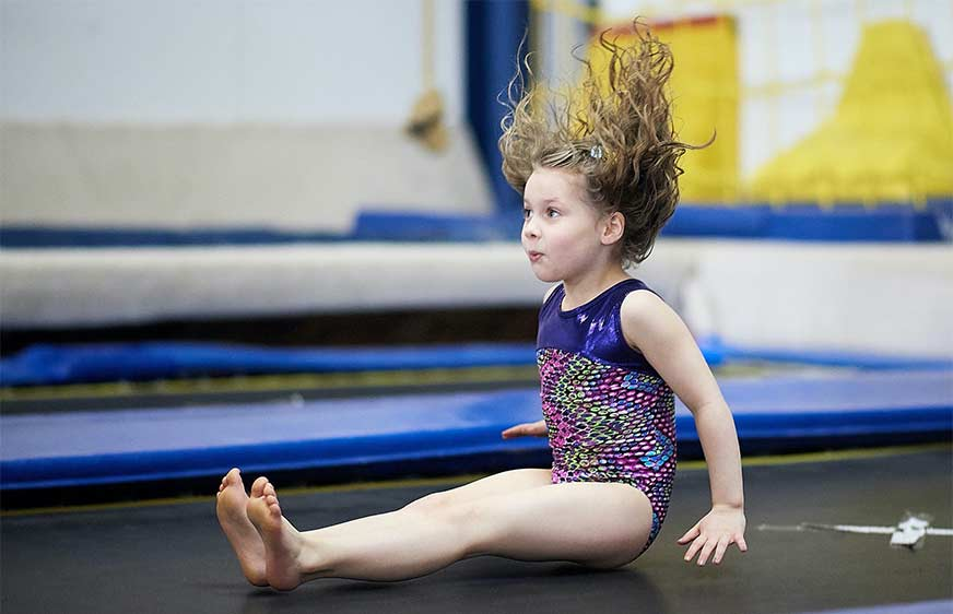 Girl on trampoline - semi-private gymnastics classes