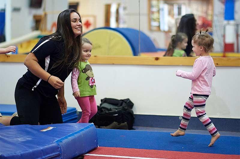 Preschool Gymnastics - on the runway with a coach