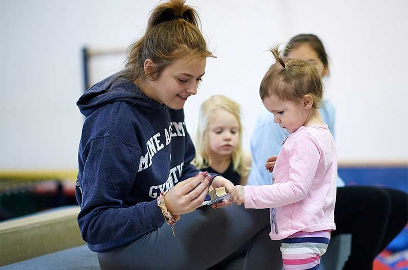 Preschool Recreational Classes - coach assisting student