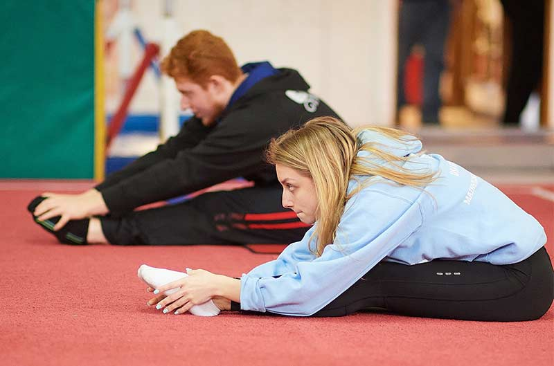 Recreational Gymnastics coaches stretching