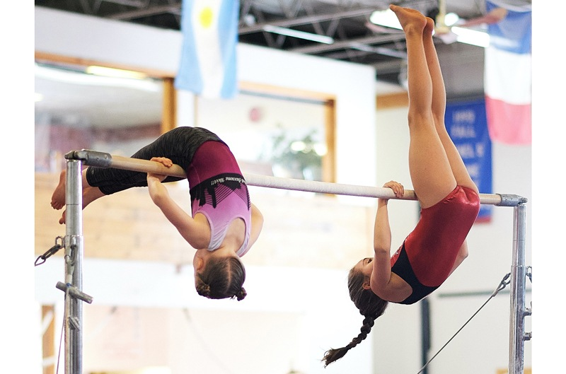 Pre-team gymnastics girls on high bar