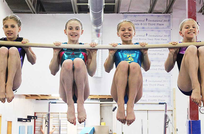 Pre-team gymnastics girls on the high bar