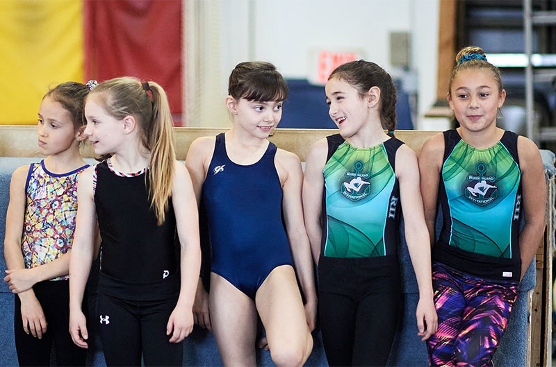 Pre-team gymnastics girls waiting their turn
