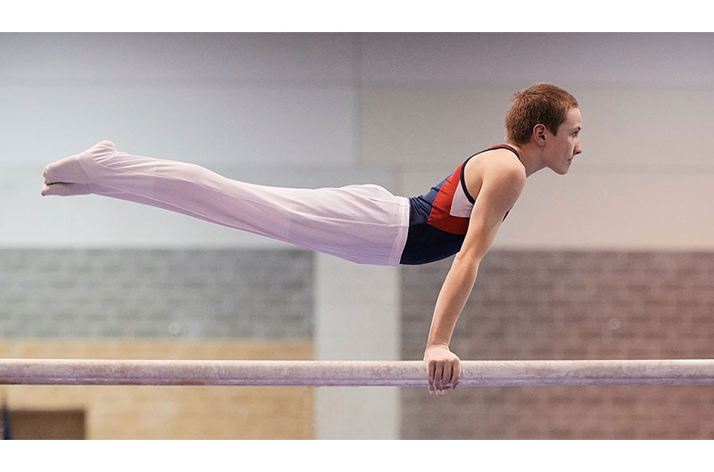 Competitive gymnast on parallel bars
