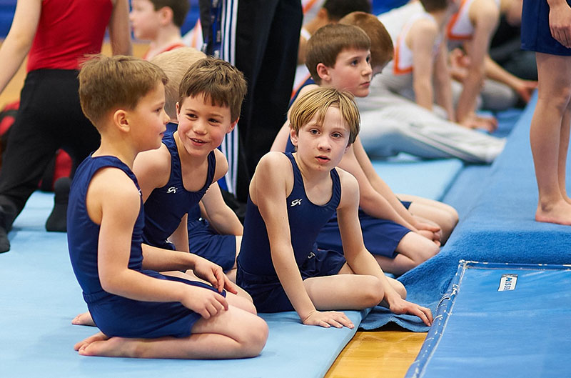 Maine Academy of Gymnastics boys team waiting for their turn in the rotation