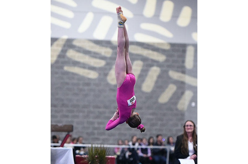 Gymnastics girl performing a twist in a floor routine