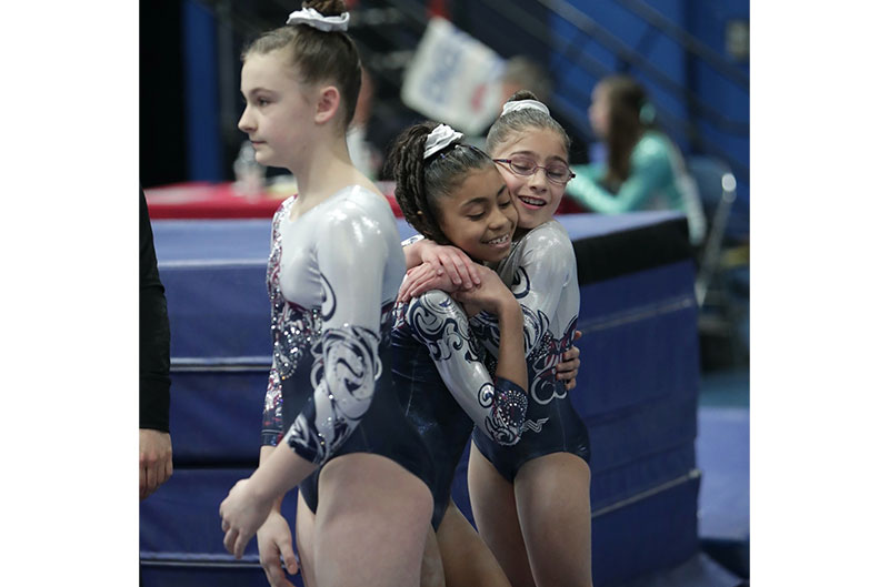 Girls hugging after a routine